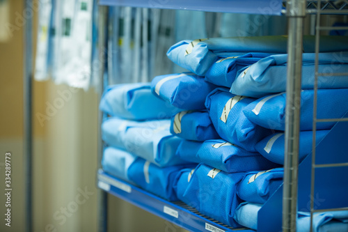 Obraz na plátne Personal Protective and sterilized gowns ready for doctors and nurses in hospita