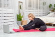 Mature woman doing sports at home on a Mat, healthy lifestyle concept