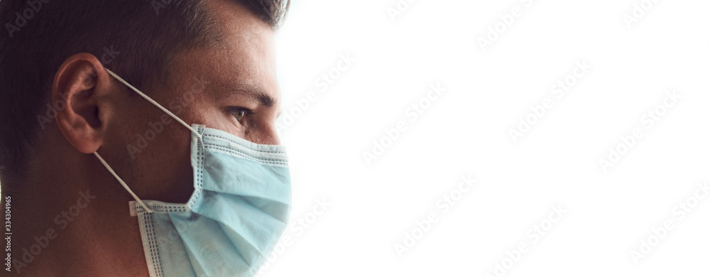 Fototapeta Profile of young sad and tired doctor isolated on white background.