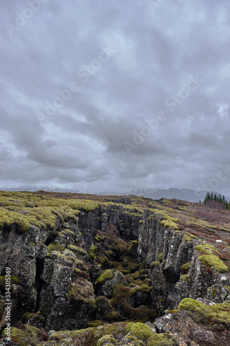 The Tektonic plates split in Iceland on a cloudy and drizzly day Wallpaper Mural
