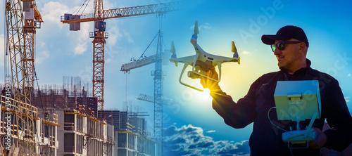 Fotografering A person launches a drone to monitor hard-to-reach areas of a future building