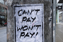 """A Sign That Reads """"Can't Pay, ..."""