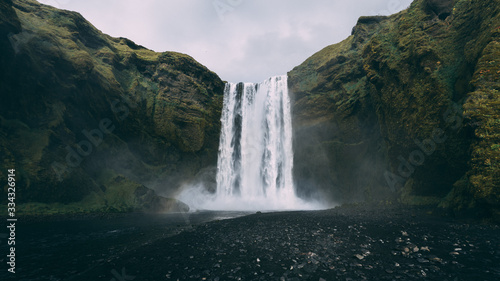 Majestic eye line view on icelandic waterfall - Skogafoss, Autumn - 334326914
