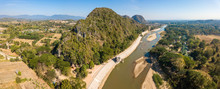 Aerial View Of The Mountain Landscape With Kok River A River Flowing Out Of The Hills Of Burma's Shan State Winding Its Way Across Chiang Rai Province To Mekong River. Panorama View From Drone.