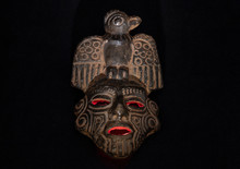 An Ancient Ceramic Pre Columbus Mask Based In American Indigenous Tribes Art Iluminated By Red Light Inside And White Light Over Black Background