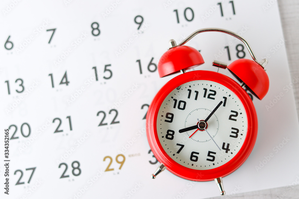 Fototapeta カレンダーと赤色の時計