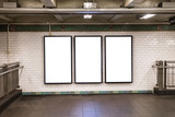 Fototapeta Nowy York - advertisement billboards electronic displays in a subway station in New York City