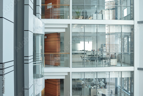 Fotografie, Obraz Several floors inside large business center with balconies, windows and offices