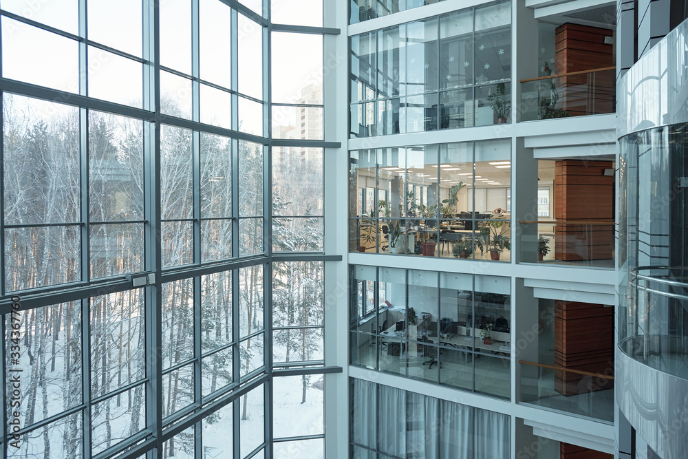 Fototapeta Several floors of large contemporary business center with open space offices