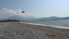 Fethiye, Turkey - 27th Of Martch 2020: 4K Kitesurfing Sportsman Turns His Kite And Rides Back Passing In Front Of Camera