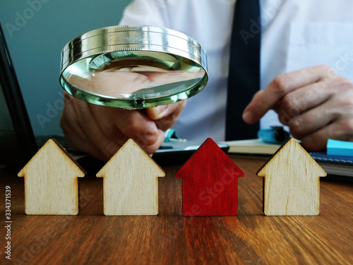 Fototapeta Realtor looking for home. Real estate investment trusts REITs investing concept. obraz