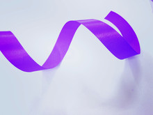 Purple Blue Ribbon On Light Blue Background