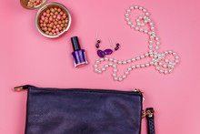 Clutch Bag, Pearl Necklace, Earrings, Nail Polish And Rouge Balls On Pink Background. Beauty And Fashion Concept. Flat Lay, Top View