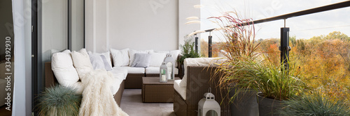 Balcony with rattan furniture, panorama Wallpaper Mural