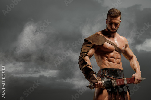 Rome gladiator attacking on dramatic outdoor nature Fotobehang