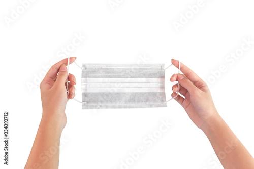 Fotografie, Obraz Hand holding medical protective mask on white background