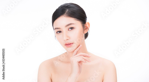Obraz Closeup portrait of beauty asian woman with fair perfect clear healthy glow skin hand touch chin, young beautiful asia girl with pretty smile on face. Beauty korean clinic facial skincare banner - fototapety do salonu