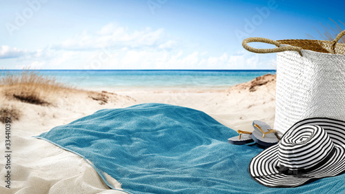 Fotomural towel on sand and beach background