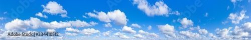 Obraz Panoramic fluffy cloud in the blue sky. Sky with cloud on a sunny day. - fototapety do salonu