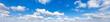 Leinwandbild Motiv Sky with cloud on a sunny day. Panoramic fluffy cloud in the blue sky.