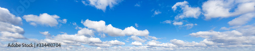 Sky with cloud on a sunny day. Panoramic fluffy cloud in the blue sky.  - 334410704