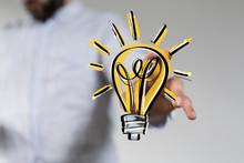 Idea Lamp Concept In Hand.