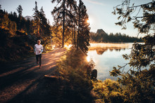 Trail Runner In Wild Nature By...