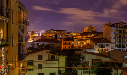Photo view of city Aversa in the evening with lights on