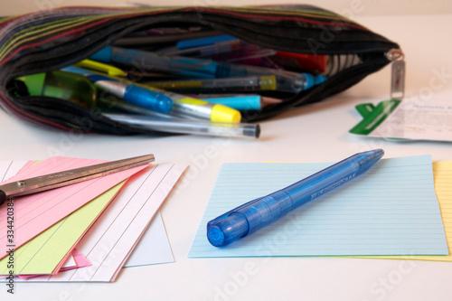 Stampa su Tela Child's homeschooling desk with pencil case, pencil and paper, white desk
