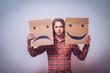 Leinwandbild Motiv Conceptual image of a man changing his mood from bad to good