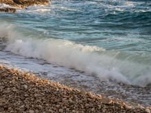 Tide Coming On Pebble Beach In Croatia