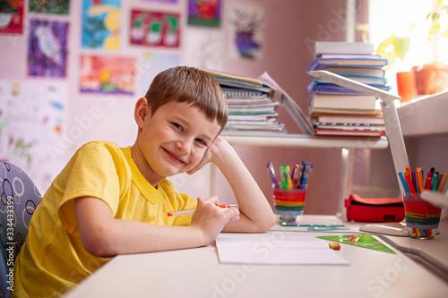 Vászonkép Happy child doing homework