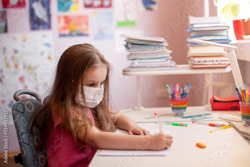 Valokuva Child doing homework with books and textbooks at home