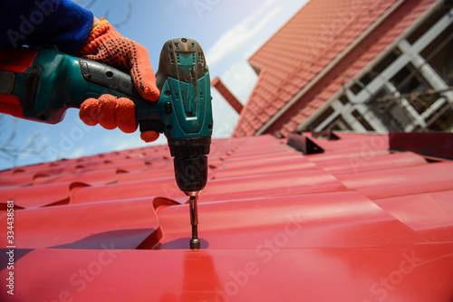 Obraz Close up hands in protective gloves of young man worker - fototapety do salonu