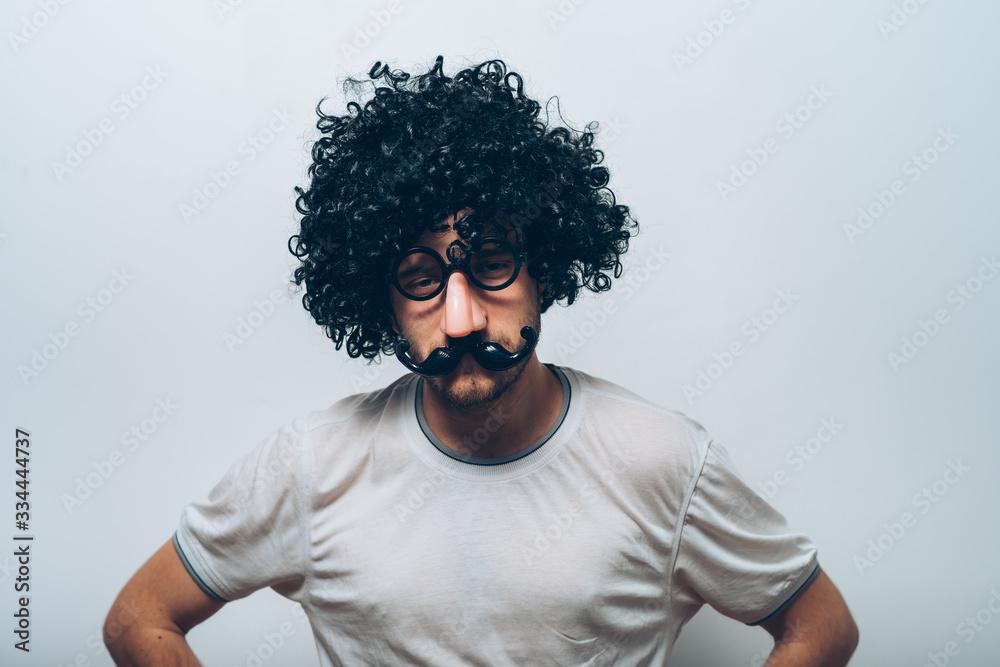 Fototapeta Young guy in black wig