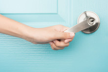 Hand Open Door Knob Blue Backg...