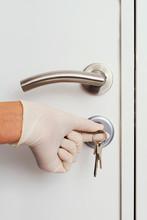 Man Opening A Door Wearing Lat...