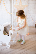 Little Cute Girl In A White Dr...