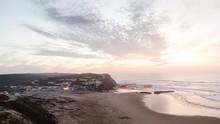 Algarve Clifftop View Of Monte Clerigo Beach At Dusk.