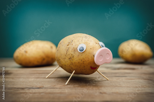 Funny potato in the shape of a pig Wallpaper Mural