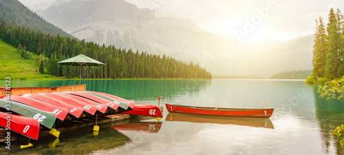 Canoes at Emerald lake near Golden in Yoho National park in the canadian Rocky M Wallpaper Mural
