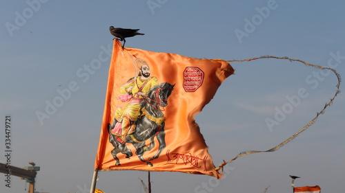 Mumbai, Maharastra/India- March 30 2020: Waving saffron flag of Shivaji Maharaj in clear sky Wallpaper Mural