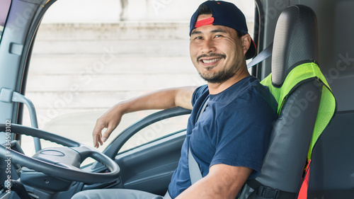 Obraz The smile of a professional truck driver in a long transportation - fototapety do salonu