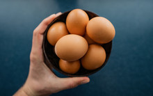 Person Choosing The Best Egg F...
