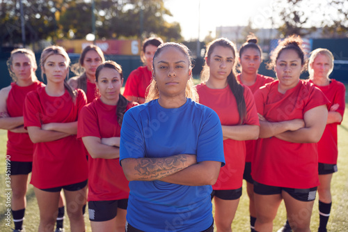 Fototapeta Portrait Of Womens Football Team With Manager Training For Soccer Match On Outdoor Astro Turf Pitch obraz