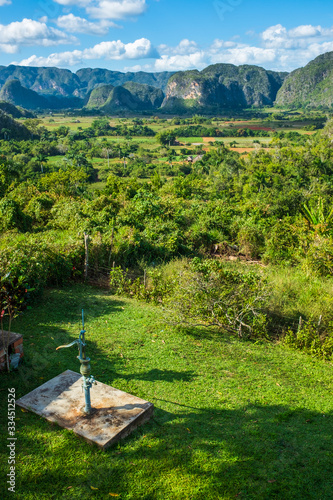 Traditional water well pump and landscape in the mountains in Vinales, Cuba Wallpaper Mural