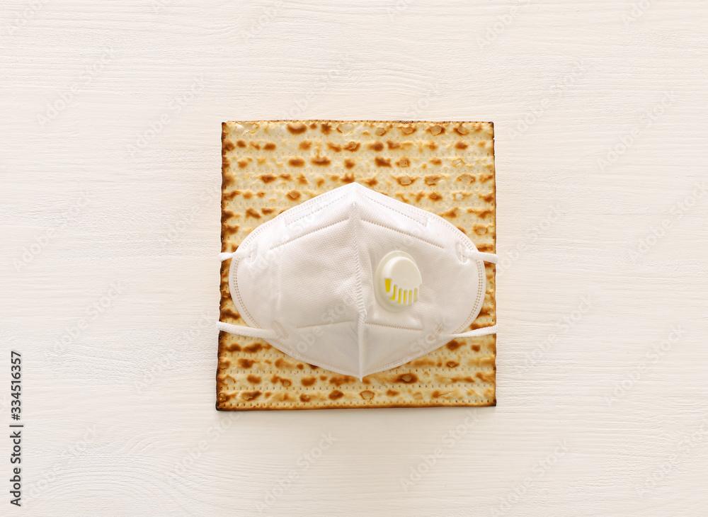 Fototapeta Pesah celebration image (jewish Passover holiday). Corona Virus Outbreak. Social distance