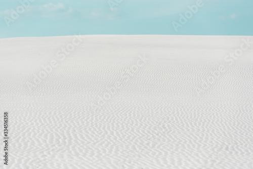 Fototapeta beautiful beach with white textured sand and blue sky obraz