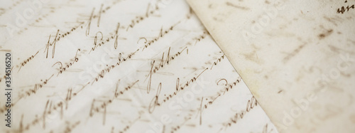 closeup of old handwriting; vintage paper background