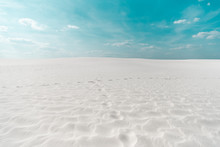 Beautiful Clean Beach With White Sand And Blue Sky With White Clouds